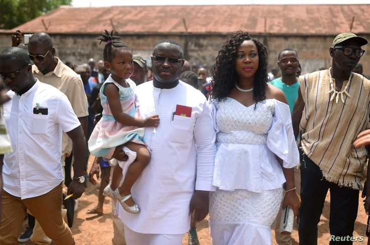 Julius Maada Bio, the presidential candidate for the Sierra Leone People's Party, arrives with his wife and daughter to cast his vote during a presidential run-off in Freetown, Sierra Leone, March 31, 2018.