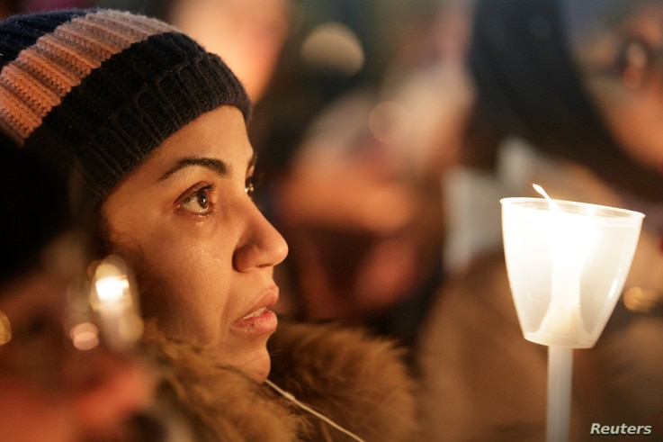 A woman becomes emotional during a vigil in support of the Muslim community in Montreal, Quebec, Jan. 30, 2017.