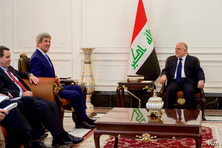 U.S. Secretary of State John Kerry, second from left, sits with Iraqi Prime Minister Haider Al-Abadi inside the prime minister's Palace in Baghdad, Iraq, April 8, 2016.