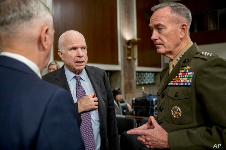 Defense Secretary Jim Mattis, left, and Joint Chiefs Chairman Gen. Joseph Dunford, right, speak with Chairman Sen. John McCain, R-Ariz., second from left, as they arrive to testify on Afghanistan before the Senate Armed Services Committee on Capitol ...
