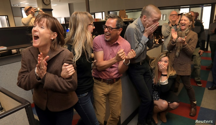 The staff of the Press Democrat, L-R: reporters Randi Rossmann, Julie Johnson, Martin Espinoza, JD Morris, Christi Warren, and Mary Callahan, celebrate winning the Pulitzer Prize for Breaking News Reporting for the coverage of the October fires in So...