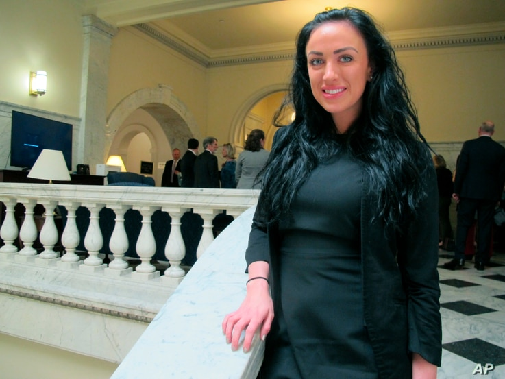FILE - Maryland Del. Meagan Simonaire poses in the Maryland State House in Annapolis, Md., May 15, 2018, after Maryland Gov. Larry Hogan signed legislation to ban gay conversion therapy for minors. Simonaire, a Republican, spoke on the House floor la...