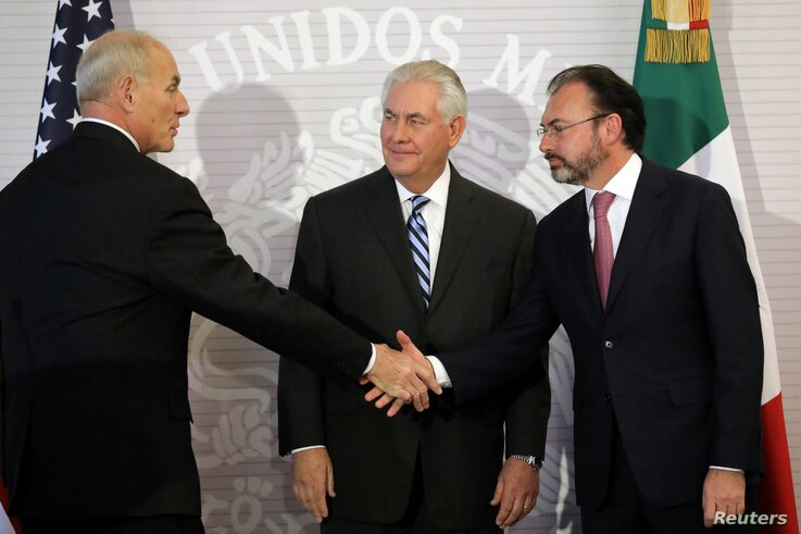U.S. Secretary of State Rex Tillerson (center) looks at Secretary of Homeland Security John Kelly as he shakes hands with Mexico's Foreign Secretary Luis Videgaray (right) after delivering statements at the Ministry of Foreign Affairs in Mexico City,...