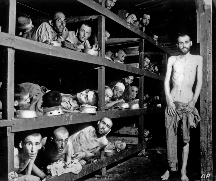 FILE -- In this April 16, 1945 black and white file photo, inmates of the German KZ Buchenwald are seen inside their barracks a few days after U.S troops liberated the concentration camp near Weimar, Germany. President Barack Obama is scheduled Frida...