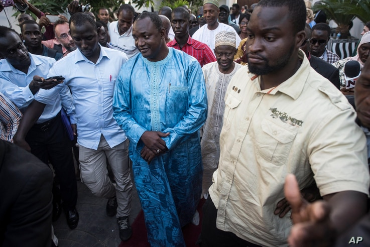 Gambia President elect, Adama Barrow, center, walks after a meeting with Ecowas delegation in Banjul, Gambia, Dec. 13, 2016.