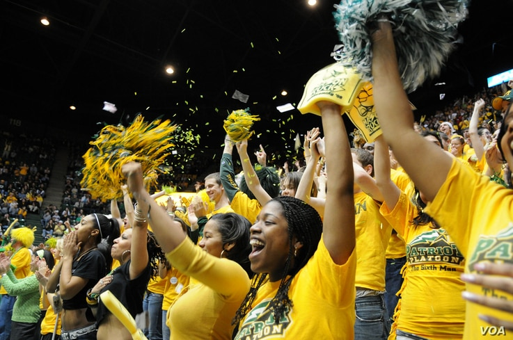 FILE -- Students cheering on the Patriots basketball team in the Patriot Center at George Mason University in Fairfax, Virginia. (Photo by George Mason Business)