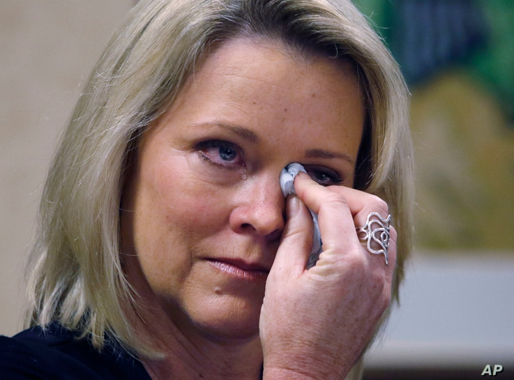 Former Boston television news anchor Heather Unruh wipes tears while speaking Nov. 8, 2017, in Boston about the alleged sexual assault of her teenage son by actor Kevin Spacey in the summer of 2016 on Nantucket.