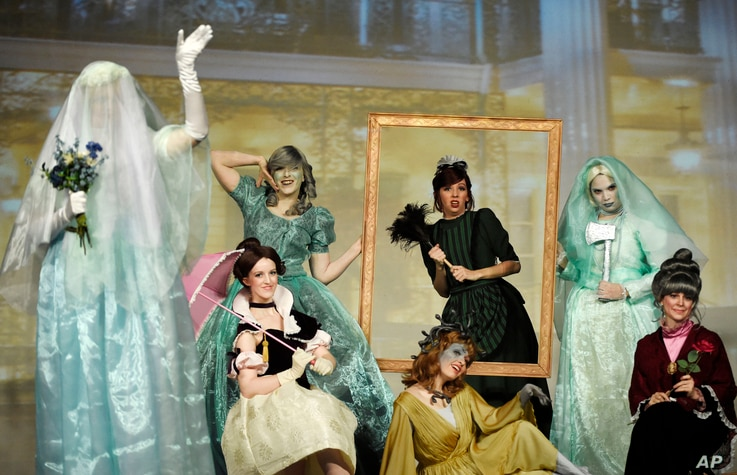 """Contestants """"The Women of the Haunted Mansion"""" perform onstage during the 41st Annual Comic-Con Masquerade costume competition on Saturday, July 11, 2015, in San Diego, Calif."""