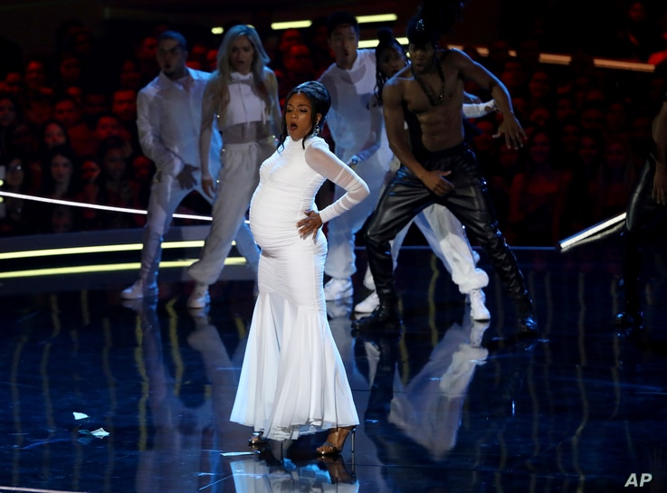 """In this Saturday, June 16, 2018, photo, Tiffany Haddish performs a rendition of """"Bodak Yellow"""" at the start of the MTV Movie and TV Awards at the Barker Hangar in Santa Monica, Calif."""