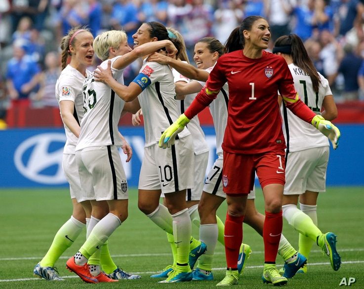United States' Carli Lloyd (3-L) celebrates with teammates, including goalkeeper Hope Solo (1), after Lloyd scored her third goal against Japan during the first half of the Women's World Cup soccer championship in Vancouver, Canada, July 5, 2015.