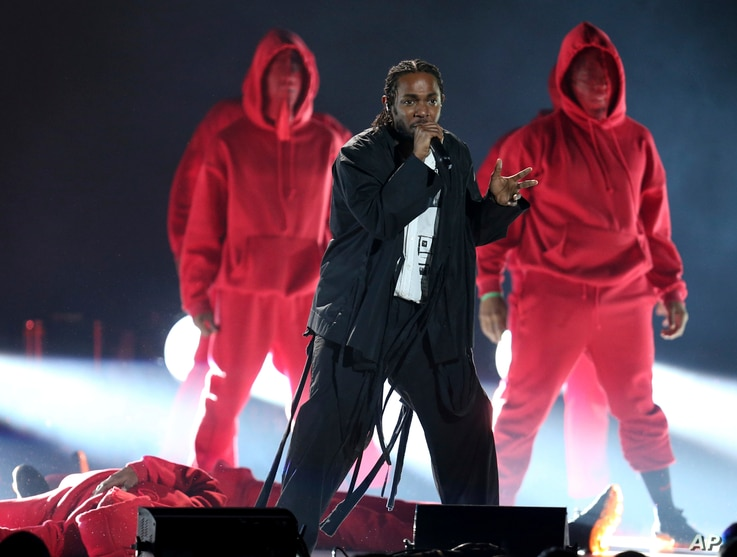 Kendrick Lamar, center, performs at the 60th annual Grammy Awards at Madison Square Garden on Sunday, Jan. 28, 2018, in New York.