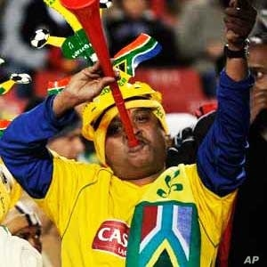 South African fans show their enthusiasm by blaring vuvuzela trumpets