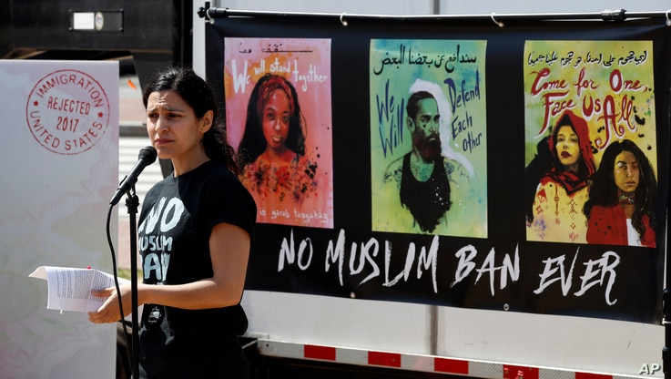 Avideh Moussavian, Senior Policy Attorney, National Immigration Law Center, speaks during a media availability for a video installation to protest President Donald Trump's ban on Muslims, April 23, 2018, at Union Station in Washington.