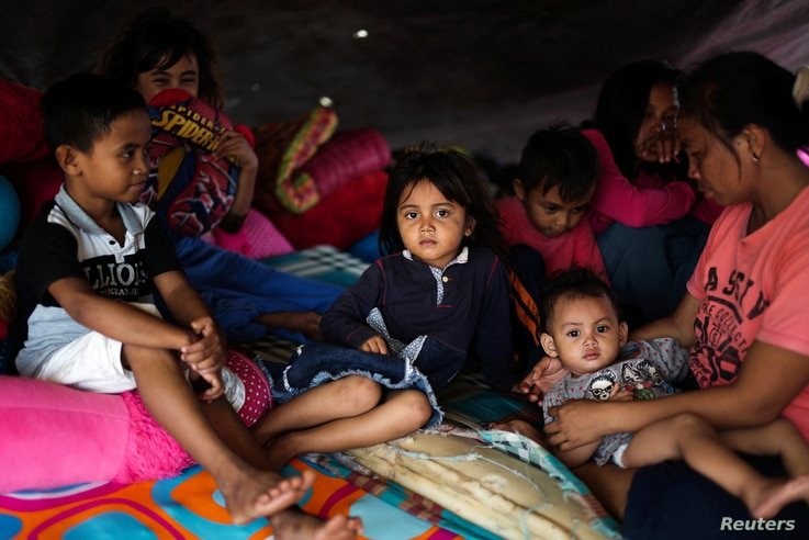 A family affected by the earthquake and tsunami is pictured at a temporary shelter in Donggala, Central Sulawesi, Indonesia Oct. 3, 2018.