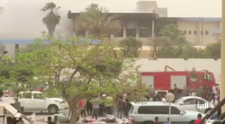 The site of suicide attack on Libyan electoral commission is seen in Tripoli, Libya, May 2, 2018 in this still picture obtained from social media video. (Al-Nabaa Channel/via Reuters)