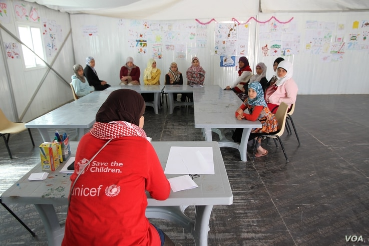 A discussion group organized by UNICEF and Save the Children in a Child Friendly Space in the Zaatari camp, where teenage girls discuss issues such as education, protection, family.  Courtesy: UNICEF/Alexis Masciarelli