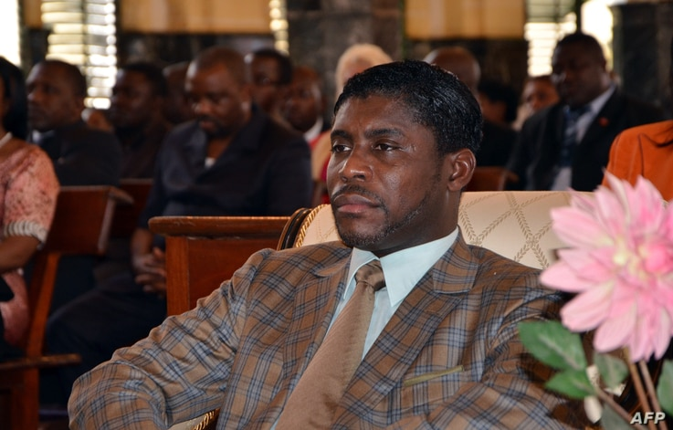 FILE - Teodorin Obiang Nguema, the son of Equatorial Guinea's president Teodoro Obiang Nguema sits during a mass at Malabo's Cathedral to celebrate his 41st birthday, June 25, 2013.