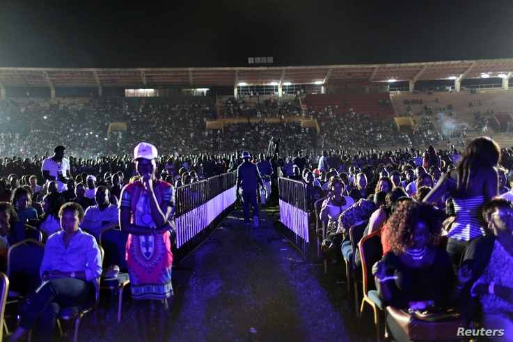 Fans of Nigerian pop star Wizkid wait for him to perform at a concert in Bamako, Mali, Nov. 15, 2015.