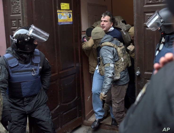 The Ukrainian Security Service officers detain Mikheil Saakashvili at the entrance of his house in Kiev, Ukraine, Dec. 5, 2017.