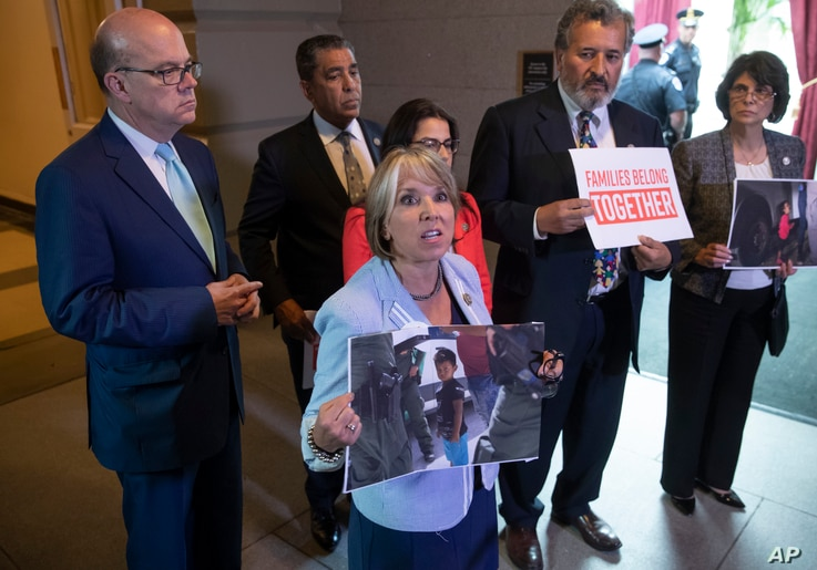 Democratic lawmakers shout in protest as President Donald Trump meets at the Capitol Tuesday, June 19, 2018, with House Republicans to discuss a GOP immigration bill. Congressional Hispanic Caucus Chair Rep. Michelle Lujan Grisham, D-N.M., center, ho...