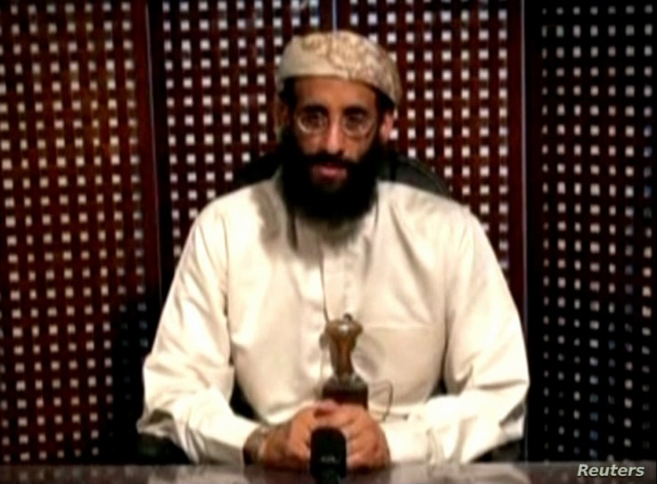 FILE - Anwar al-Awlaki, a U.S.-born cleric linked to al-Qaida's Yemen-based wing, gives a religious lecture in an unknown location in this still image taken from video released by Intelwire.com on Sept. 30, 2011.
