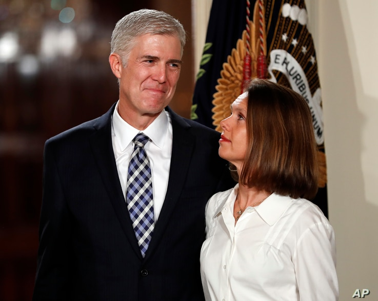 Judge Neil Gorsuch stands with wife Louise as President Donald Trump announces him as his choice for the Supreme Court at the East Room of the White House in Washington, Jan. 31, 2017.