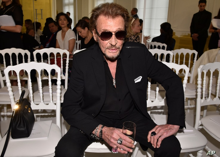 French rock singer Johnny Hallyday, seen in this July 4, 2016 photo, is being treated in a Paris hospital for respiratory difficulties, French television station BFM reported on Friday, Nov. 17, 2017.