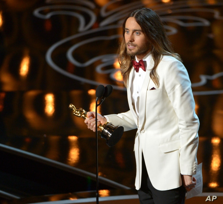"""Jared Leto accepts the award for best actor in a supporting role for """"Dallas Buyers Club"""" during the Oscars at the Dolby Theatre on March 2, 2014, in Los Angeles."""