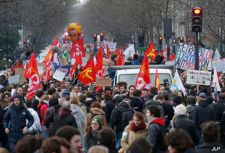 Demonstrators hold union flags march during a rally in Paris, France, March 9, 2016.