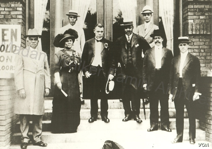 Madam C.J. Walker with Booker T. Washington and other men at the opening of a YMCA building in 1913.