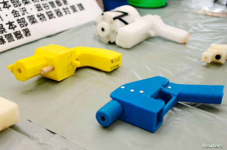 FILE - Seized plastic handguns created with 3-D printing technology are displayed at Kanagawa police station in Yokohama, south of Tokyo, May 8, 2014.