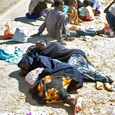 Somali asylum seekers rest on side of main road after an exhausting trip upon arrival on the beach of Hasn Beleid village, east of Red Sea port of Aden (file photo)