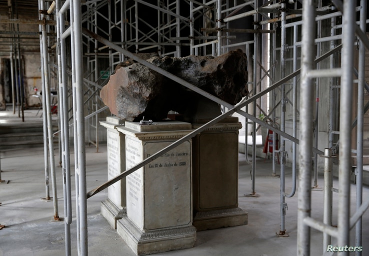 A meteorite on exhibit at the entrance of Brazil's National Museum stills stands at its original place after a fire destroyed the building in 2018, in Rio de Janeiro, Feb. 12, 2019.