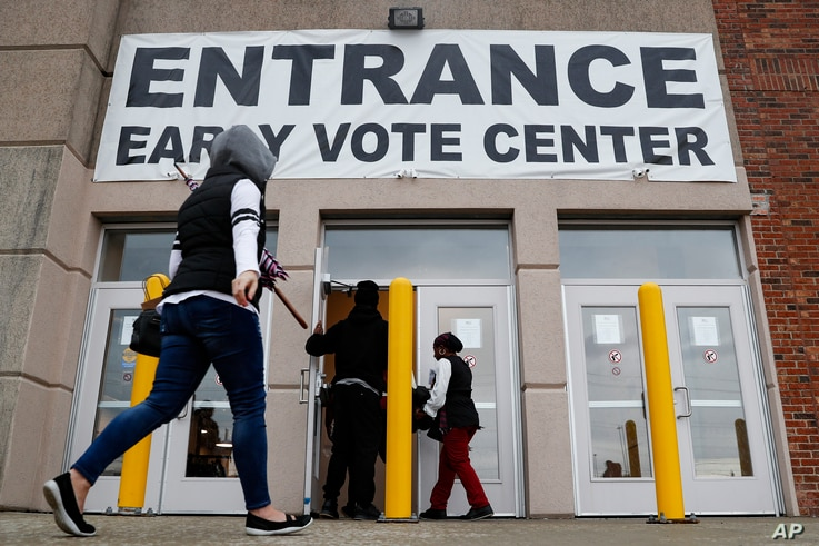 FILE - Voters arrive to vote early at the Franklin County Board of Elections, Oct. 31, 2018, in Columbus, Ohio.