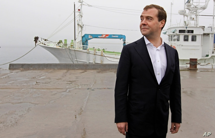 FILE - Russian Prime Minister Dmitry Medvedev visits a berth in the Yuzhno-Kurilsk bay in the town of Yuzhno-Kurilsk, on the Kunashir Island of the Kuril Islands, Russia, July 3, 2012.
