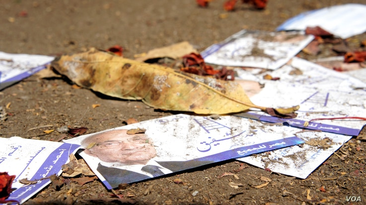 Campaign paraphernalia scattered after protesters are said to have stormed Ahmed Shafiq's headquarters in Cairo, May 29, 2012. (E. Arrott/VOA)