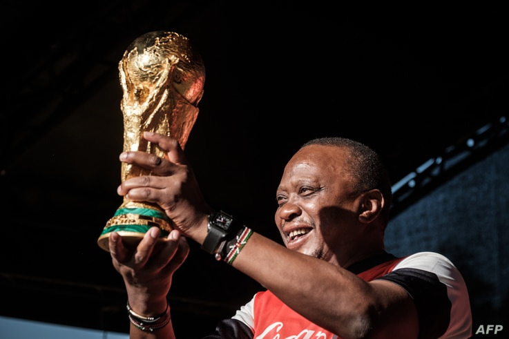 Kenya's President Uhuru Kenyatta holds the FIFA World Cup Trophy during its World Tour at the State House in Nairobi, Feb. 26, 2018.