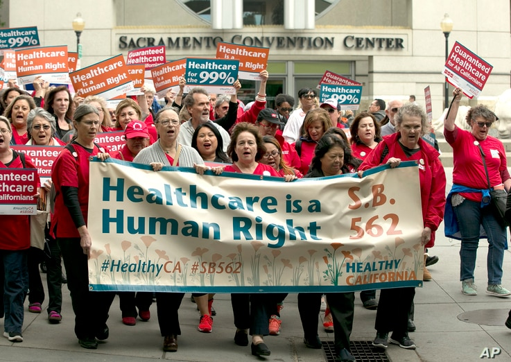 Supporters of single-payer health care march to the Capitol in Sacramento, Calif., April 26, 2017.