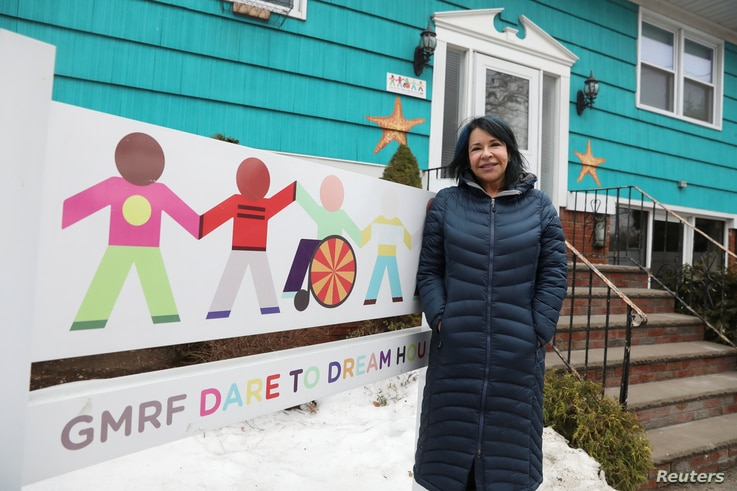 Elissa Montanti, founder of the Global Medical Relief Fund, stands outside one of her homes in the Staten Island borough of New York, March 24, 2017.