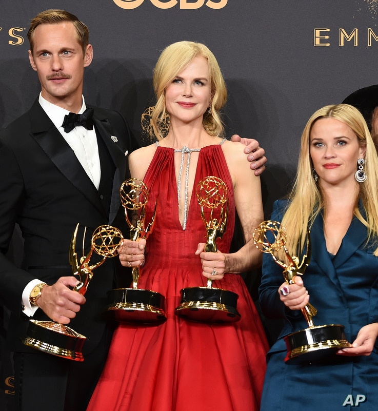 "Alexander Skarsgard, from left, Nicole Kidman, and Resse Witherspoon pose in the press room with their awards for outstanding limited series for ""Big Little Lies"" at the 69th Primetime Emmy Awards, Sept. 17, 2017."