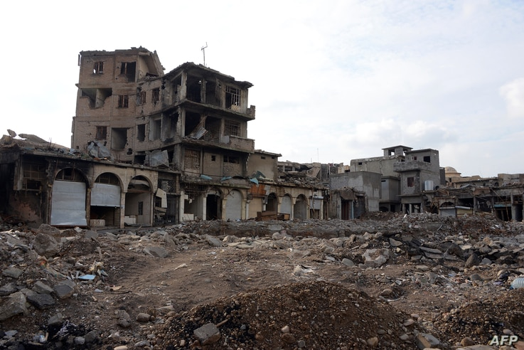 "A picture taken Nov. 7, 2018, shows damaged buildings in Mosul, Iraq. Iraqi forces announced the ""liberation"" of the country's second city in July 2017, after a bloody nine-month offensive to end the Islamic State group's three-year rule there. Score..."