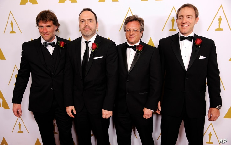 Left to right, Robert Lanciault, Andre Gauthier, Benoit Sevigny and Yves Boudreault, designers of the FILMBOX software application and recipients of a Scientific and Engineering Award, pose together at the Academy of Motion Picture Arts and Sciences'...