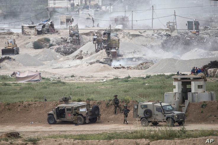 Israeli soldiers are seen near the Gaza border, March 28, 2018.