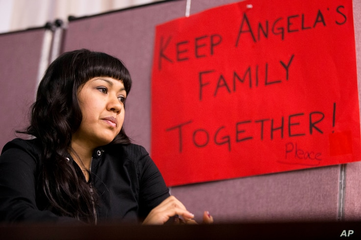 FILE - Angela Navarro, who has been living in the U.S. with her American-born children despite a deportation order issued 10 years ago, sits at the West Kensington Ministry church in Philadelphia, Dec. 8, 2014. Navarro took sanctuary with her childre...