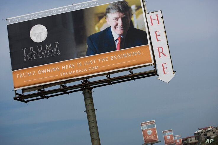 FILE - A Trump Ocean Resort Baja billboard with a photo of Donald Trump advertises condos for sale on the outskirts of Tijuana, Mexico. But the Trump Ocean Resort Baja Mexico project collapsed, and dozens of buyers who lost their 30 percent deposits ...