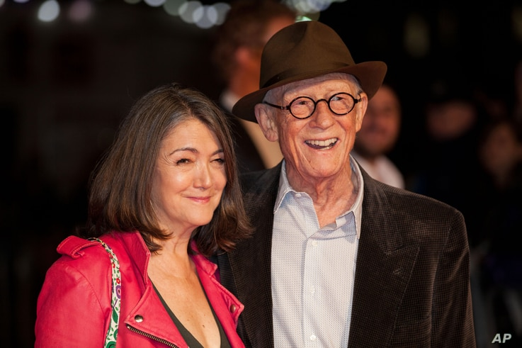"""John Hurt and wife Anwen Rees-Myers pose for photographers upon arrival at the premiere of the film """"Suffragette,"""" which is also the opening gala of the London film festival in London, Oct. 7, 2015."""