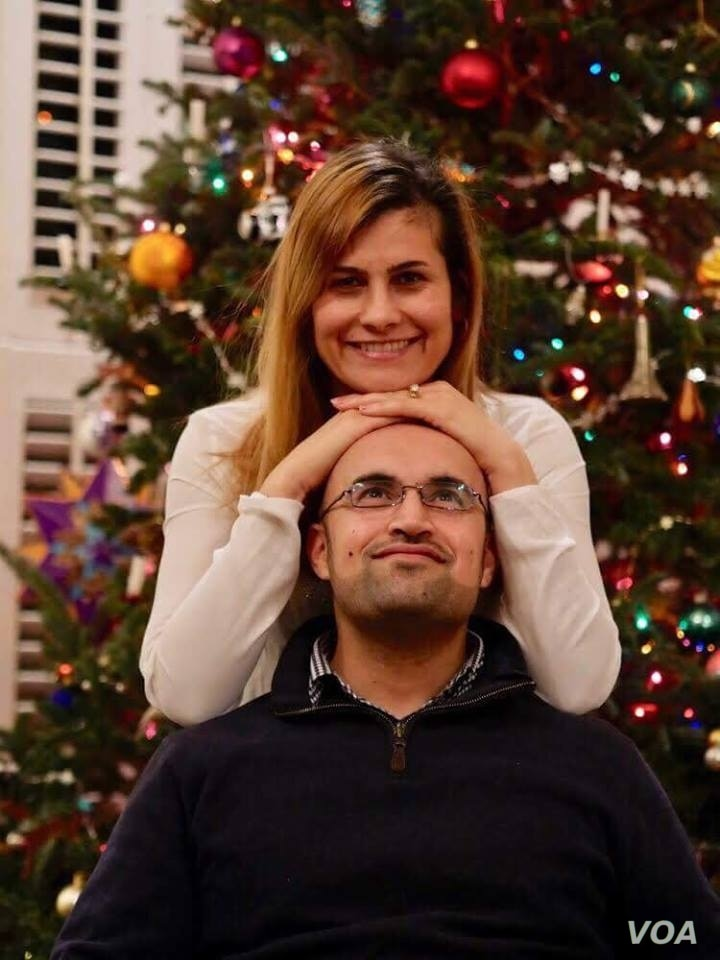 Lilah Salih, a Yazidi woman from a village outsideSinjar in northern Iraq, resettled in the U.S. with her husband in 2017. They are pictured here celebrating Christmas that year.