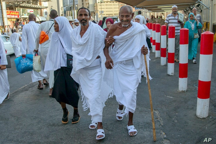 Muslim pilgrims walk toward the Grand Mosque to offer prayers ahead of the annual Hajj pilgrimage, in the Muslim holy city of Mecca, Saudi Arabia, Aug. 18, 2018.The annual Islamic pilgrimage draws millions of visitors each year, making it the largest...