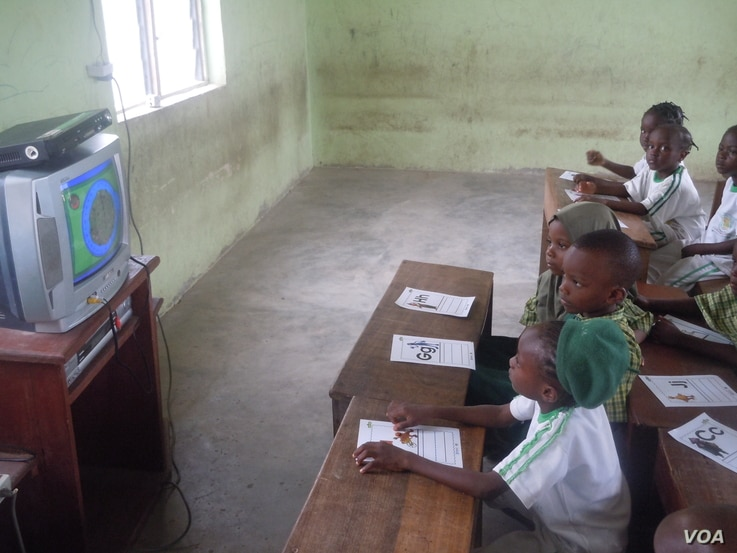 "Students watch ""Sesame Square"" in Ijebu-Lekki, Nigeria, in February 2012. Creators of ""Sesame Square"" feared being targeted by Boko Haram. (N. Moland)"