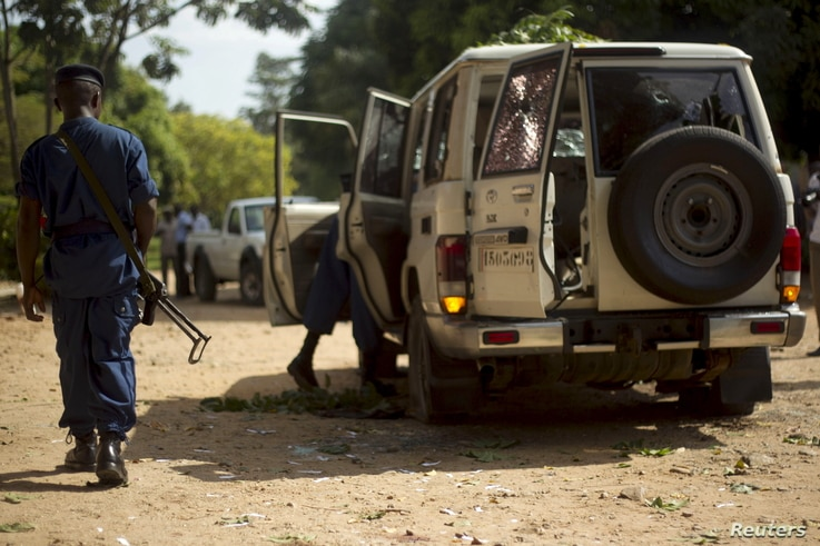 A policeman walks at the crime scene where Burundian General Athanase Kararuza was attacked and killed by unknown gunmen in Ntahangwa commune, north of the capital Bujumbura, April 25, 2016.